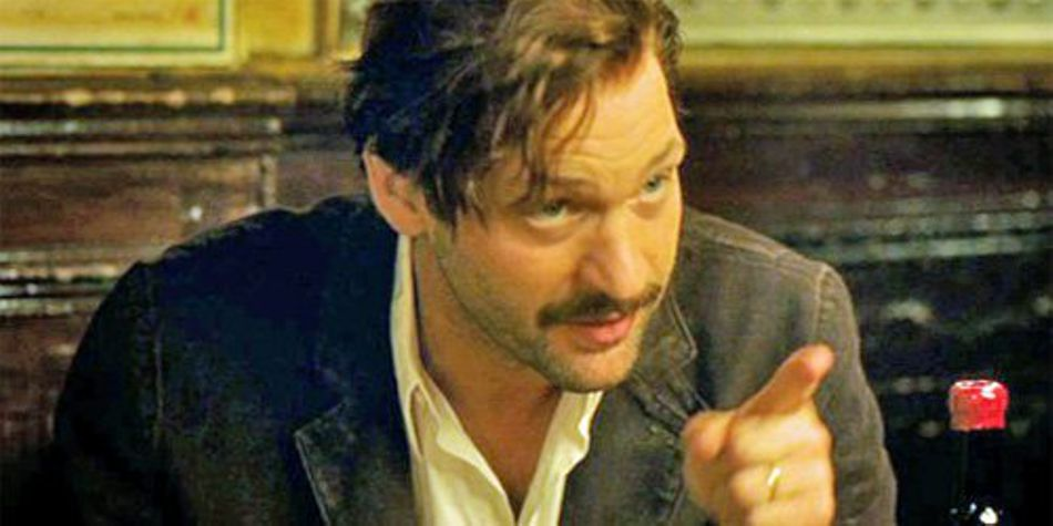 Corey Stoll as Ernest Hemingway