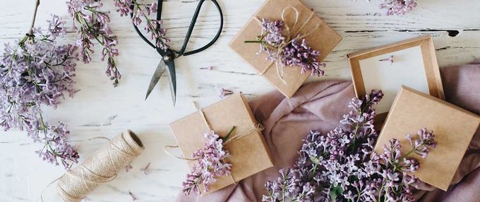 presents being wrapped with lilacs