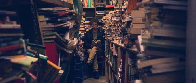 man reader in bookshop