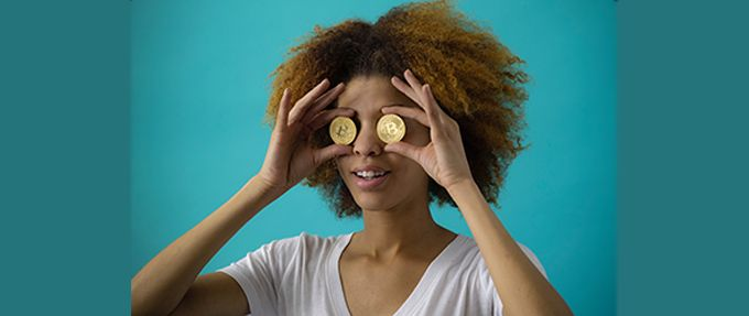 woman holding gold coins over eyes