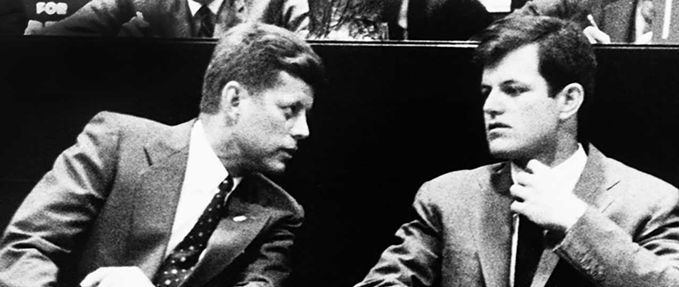 JFK leans over to talk to Ted Kennedy; cheap history books