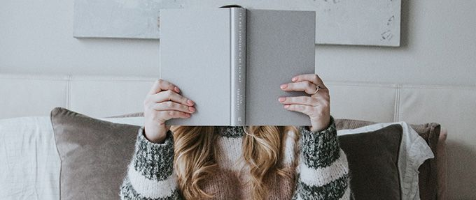 woman reading book alone