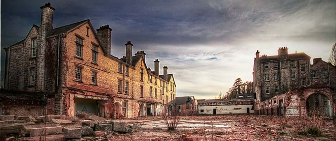Abandonded asylum at sunset