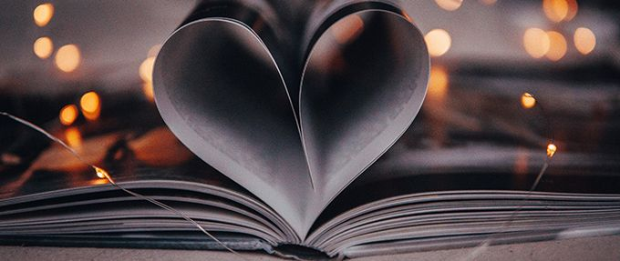 open book with pages making a heart