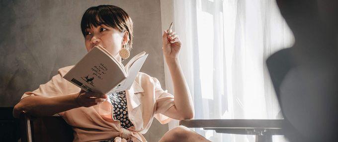 woman reading summer book club book