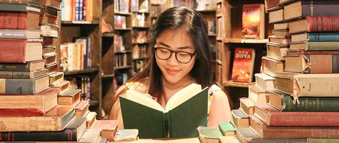 girl reading romantic book club book
