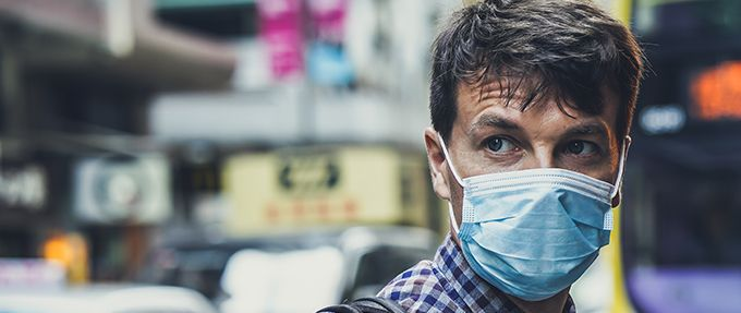 a man wearing a surgical mask to protect from disease