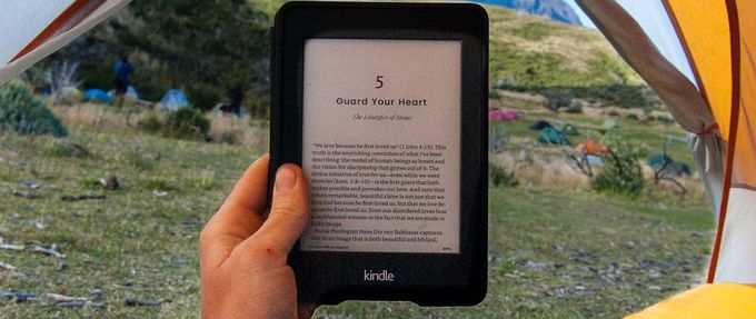 holding up ebook while camping