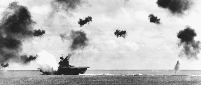 USS Yorktown is hit by a torpedo in the battle of midway, part of the pacific war in wwII