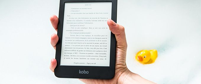 person holding up ereader with gifted ebook in bathtub