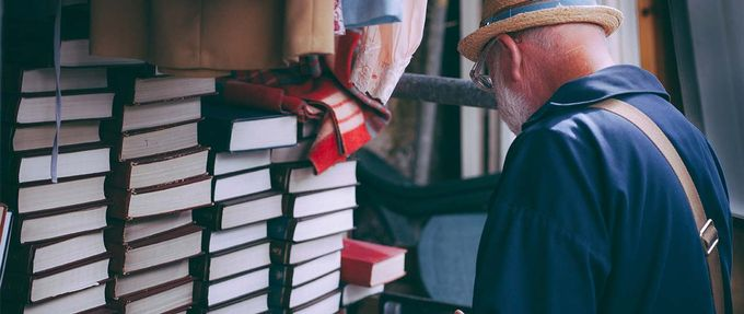 Father's Day gifts for history buffs, man browses book stack