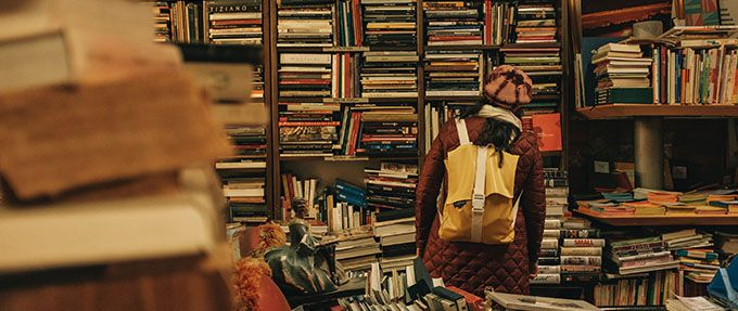 woman deciding what to read next