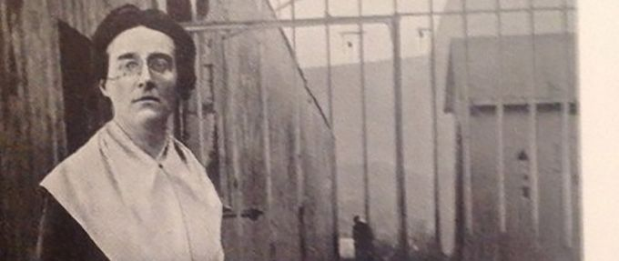 Louise Thuliez in front of jail bars