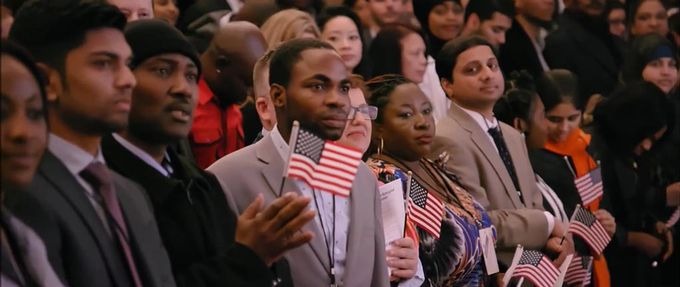 Men and women stand in a room for their swearing in ceremony. Netflix history documentaries