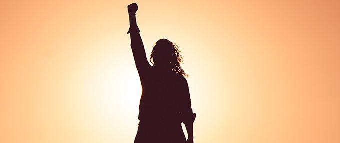 a feminist raising her fist
