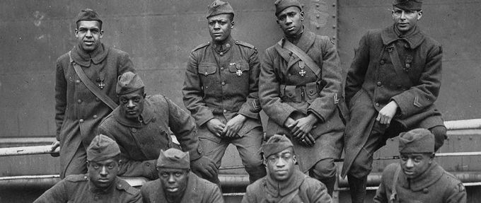 Selected Harlem Hellfighters sit for a portrait.
