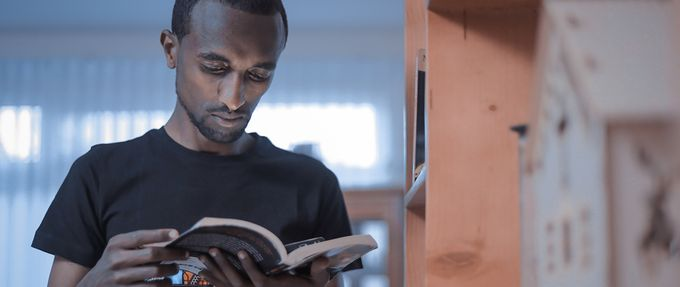 black man reading a book