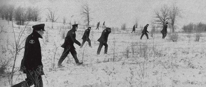 policemen walk through snow, Forest City Killer excerpt