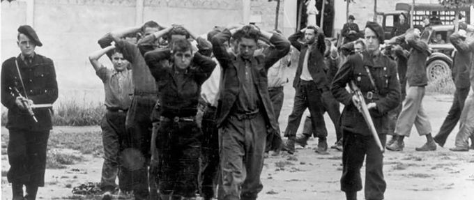 german soldiers lead captured members of the french resistance