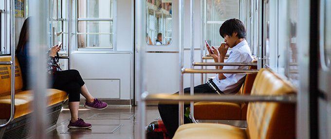 man reading on his phone