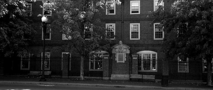 Black and white photo of Harvard; We Keep the Dead Close excerpt