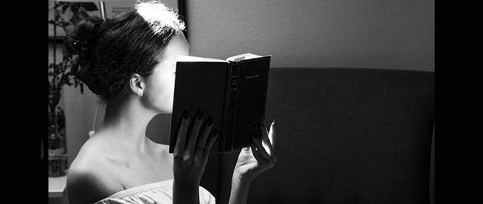 woman reading sexy romance book