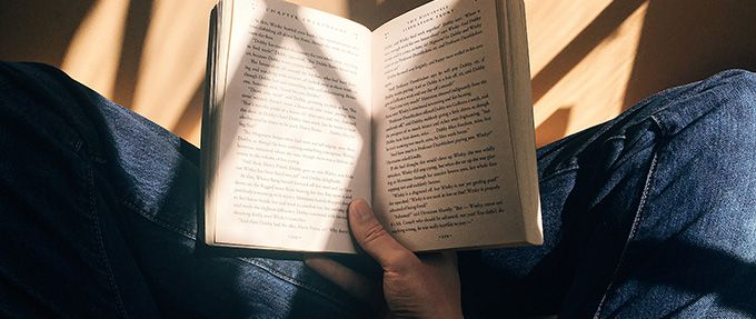 person reading in sunlight